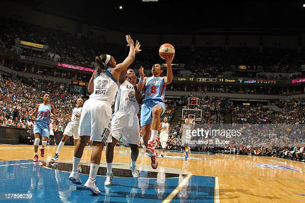 Monica Wright and Amber harris of the Minnesota Lynx defend against Iziane Castro Marques of the Atlanta Dream in Game One of the 2011 WNBA Finals on...