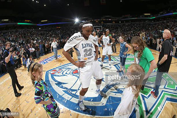 Monica Wright and Candice Wiggins of the Minnesota Lynx celebrate with fans after the 2012 WNBA Finals Game Two win over the Indiana Fever on October...