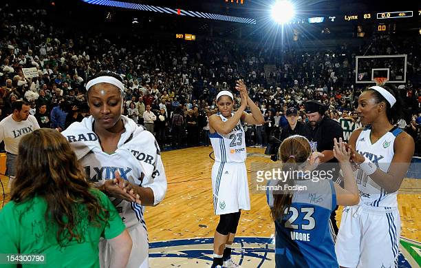 Monica Wright Maya Moore and Candice Wiggins of the Minnesota Lynx celebrate a win of Game Two of the 2012 WNBA Finals against the Indiana Fever on...