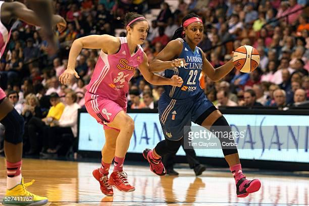 Monica Wright Minnesota Lynx drives past Kelly Faris Connecticut Sun during the Connecticut Sun Vs Minnesota Lynx WNBA regular season game at Mohegan...
