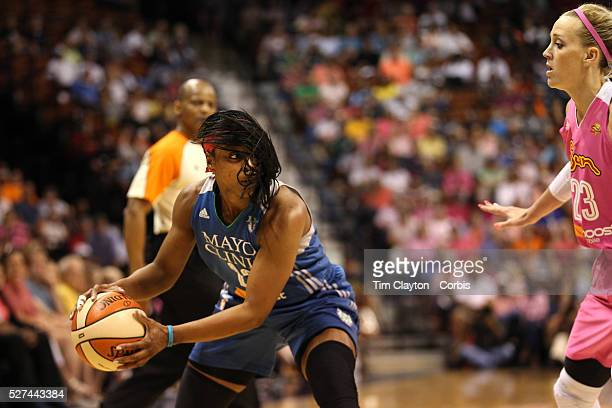 Monica Wright Minnesota Lynx prepares to pass while defend by Katie Douglas Connecticut Sun during the Connecticut Sun Vs Minnesota Lynx WNBA regular...