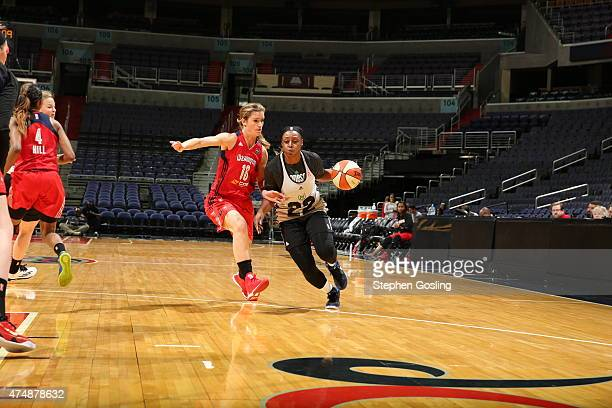 Monica Wright of the Minnesota Lynx drives against Blake Dietrick of the Washington Mystics during an Analytic Scrimmage at the Verizon Center on May...