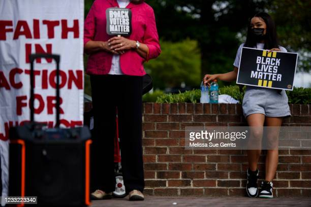 Monica Wright, sister of Daunte Wright who was killed by police, listens to other speakers during a rally on June 1, 2021 in Fayetteville, North...