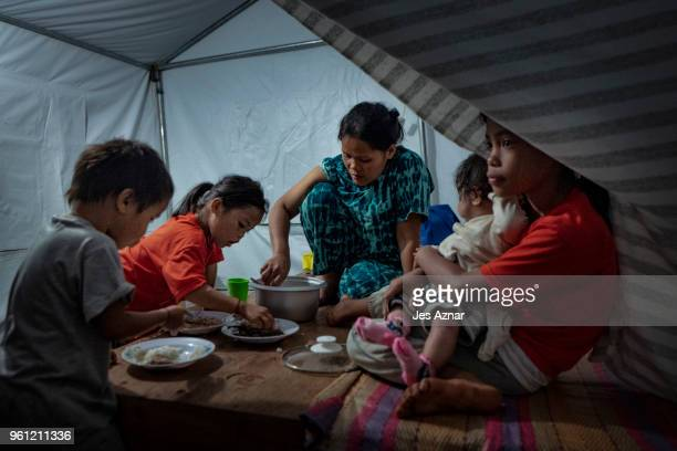 Monife Rambanjo and her family eat their last meal of the day before fasting for ramadan inside their shelter at the Sarimanok tent city on May 15...