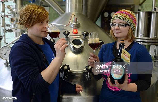 Monika and Gisela Hansen daughters of the brewery Meinel pose with socalled 'Holladiebierfee' beer in the brewhouse of the brewery in Hof southern...