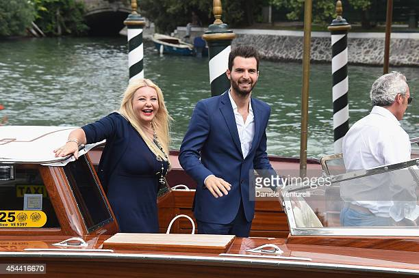 Monika Bacardi and Andrea Iervolino are seen during the 71st Venice International Film Festival on August 31 2014 in Venice Italy