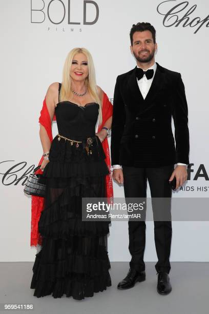 Monika Bacardi and Andrea Iervolino arrive at the amfAR Gala Cannes 2018 at Hotel du CapEdenRoc on May 17 2018 in Cap d'Antibes France