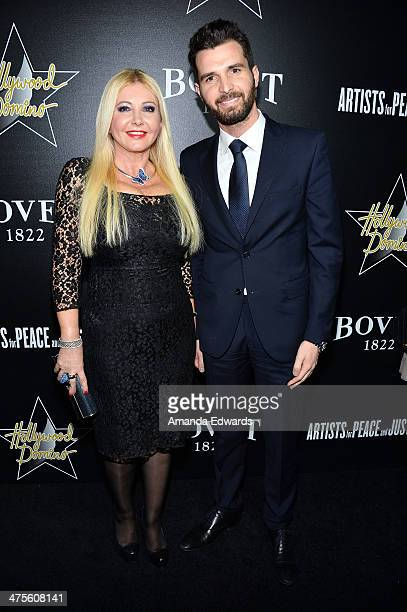 Monika Bacardi and Andrea Iervolino arrive at the Hollywood Domino's 7th Annual PreOscar Charity Gala at Sunset Tower on February 27 2014 in West...