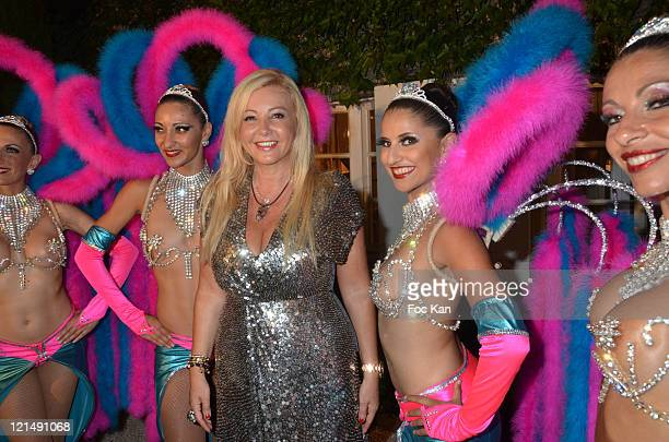 Monika Bacardi and dancers attend the Massimo Gargia Summer Party at Les Moulins de Ramatuelle on August 18, 2011 in Saint Tropez, France.