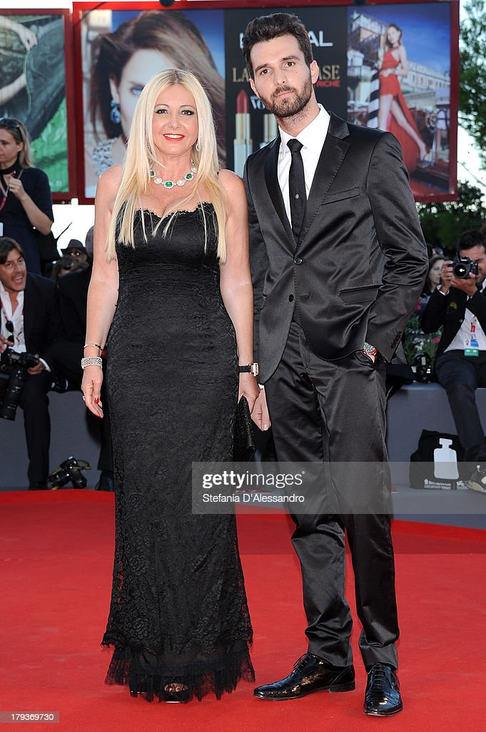 Monika Bacardi and producer Andrea Iervolino attend the 'The Zero Theorem' Premiere during the 70th Venice International Film Festival at Sala Grande on September 2, 2013 in Venice, Italy.