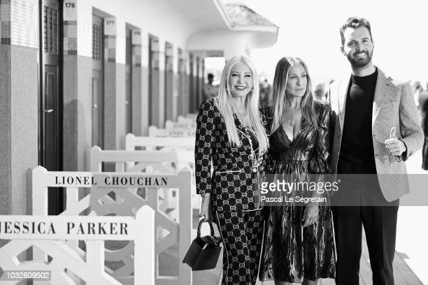 Monika Bacardi Sarah Jessica Parker and Andrea Iervolino pose at her dedicated beach closet as representation of her Deauville Talent Award at a...