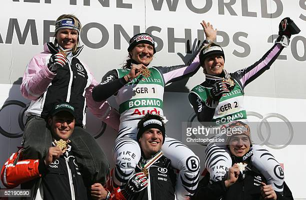 Monika BergmannSchmuderer Martina Ertl Hilde Gerg Florian Eckert Andreas Ertl and Felix Neureuther of Germany celebrate with their gold medals during...