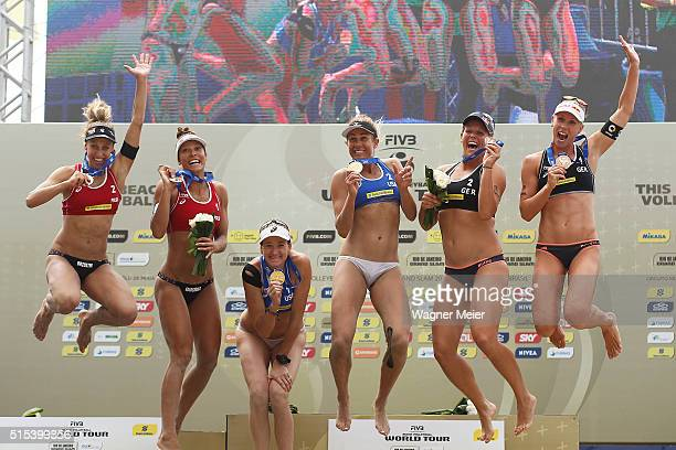 Monika Brzostek and Kinga Kolosinska of Poland Kerri Walsh and April Ross of United States Britta Buthe and Karla Borger of Germany celebrates after...