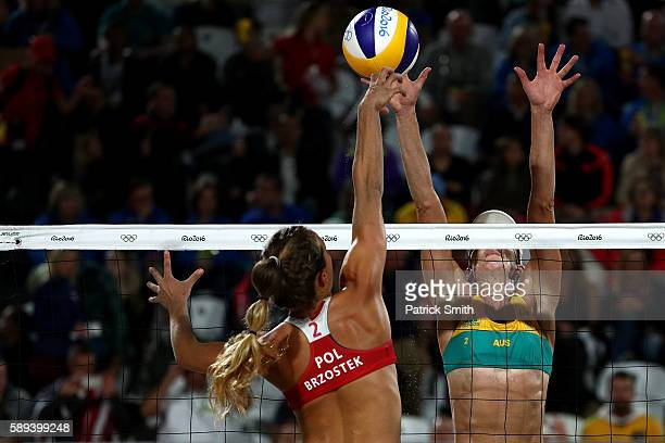 Monika Brzostek of Poland spikes the ball against Louise Bawden of Australia during a Women's Round of 16 match between Poland and Australia on Day 8...