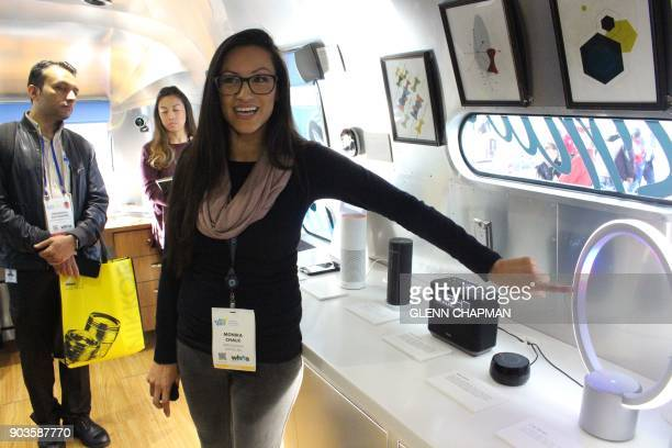 Monika Chalk of the Amazon Alexa team demonstrates an array of devices infused the company's artificial intelligence in a Roadshow trailer parked at...