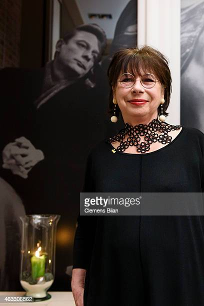 Monika Hansen poses in front of a picture showing Otto Sander at the WarmUp at the Glashuette Original lounge during the 65th Berlinale International...