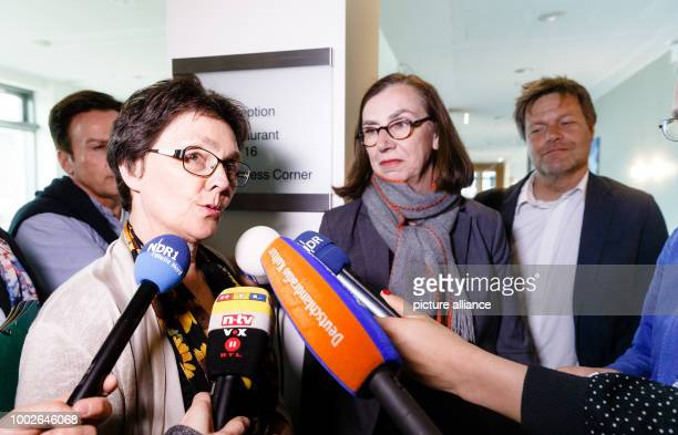 Monika Heinold member of the Alliance 90/The Greens party and SchleswigHolstein's finance minister talks to journalists as she stands next to Ruth...