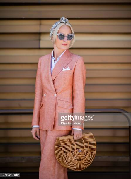 Monika Kaminska wearing double breasted wool linen suit white shirt white pocket square cult gaia bag Dolce and Gabbana sunglasses is seen during the...