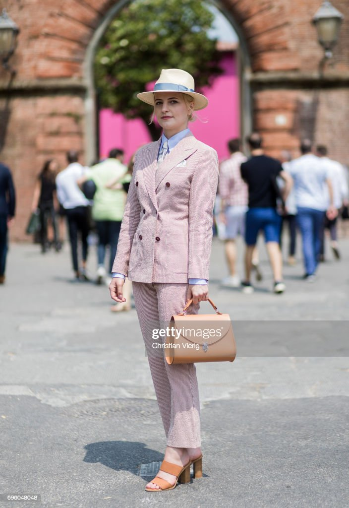 Monika Kamiska wearing a suit of her own brand Monika Kamiska, panama hat, bag, sandals, tie is seen during Pitti Immagine Uomo 92. at Fortezza Da Basso on June 14, 2017 in Florence, Italy.