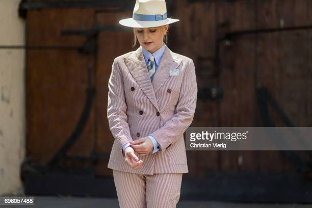 Monika Kamiska wearing a suit of her own brand Monika Kamiska panama hat bag sandals tie is seen during Pitti Immagine Uomo 92 at Fortezza Da Basso...