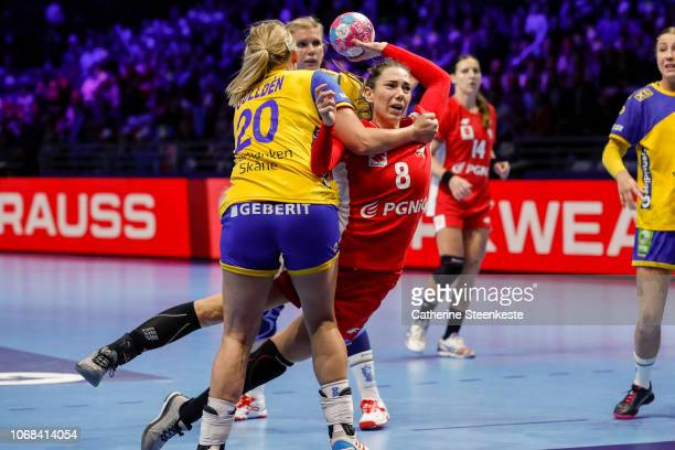 Monika Kobylinska of Poland is shooting the ball against Isabelle Gullden of Sweden during the EHF Women's Euro match between Sweden and Poland on...