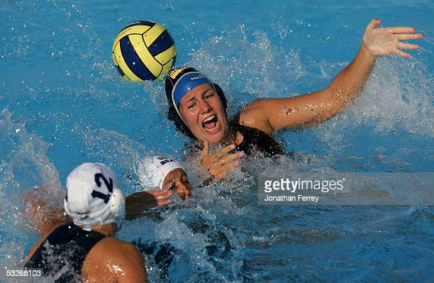 Monika Kruszona of Germany loses control of the ball under press ure from Melina Teno and Luiza Carvalho of Brazil in the preliminary match during...