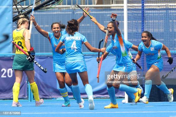 Monika, Navjot Kaur, Rani and Neha Neha of Team India celebrate the second goal scored while Jane-Anne Claxton of Team Australia walks away during...
