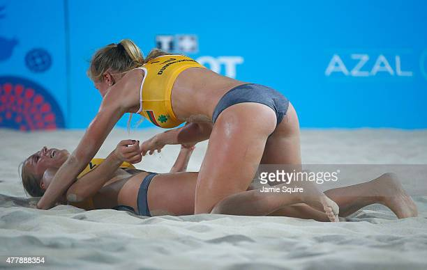 Monika Povilaityte and Ieva Dumbauskaite of Lithuania celebrate winning bronze after the Women's Beach Volleyball bronze medal match between...