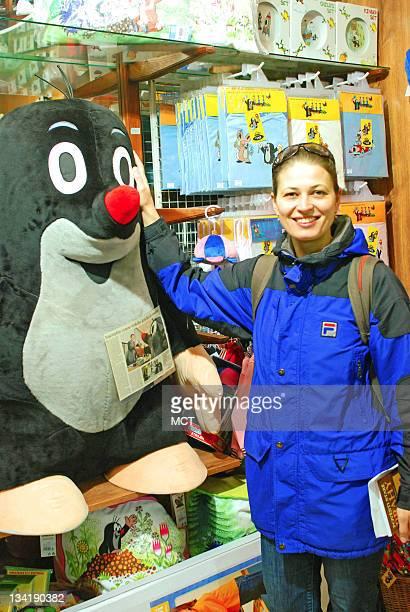 Monika Ruzickova poses for portrait with a big stuffed Little Mole