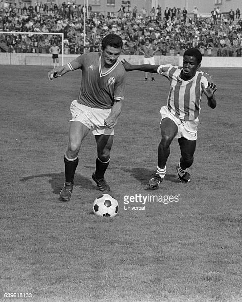 Monin of Red Star and Marius Tresor of Ajaccio during a French Championship match between the two teams