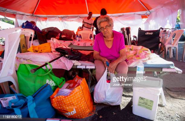 monin Oliviera Feliciano rests at the refugee camp located at the Mariano Rodríguez Coliseum on January 11 2020 in Guanica Puerto Rico Saturday...