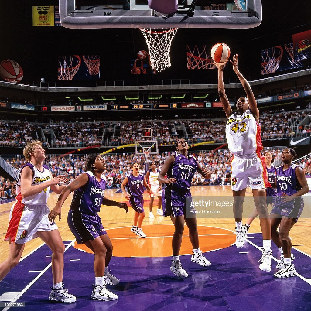 Monique Ambers #42 of the Phoenix Mercury goes up for a shot against the Sacramento Monarchs during a game played circa 1997 at the America West Arena in Phoenix, Arizona.