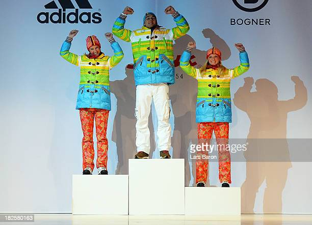 Monique Angermueller Daniel Bohnacker and Denise Herrmann are seen during the German Olympic and Paralympic team kit presentation at Messe...