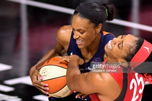 Monique Billings of the Atlanta Dream and Alyssa Thomas of the Connecticut Sun fight for the ball during the first quarter at Feld Entertainment...