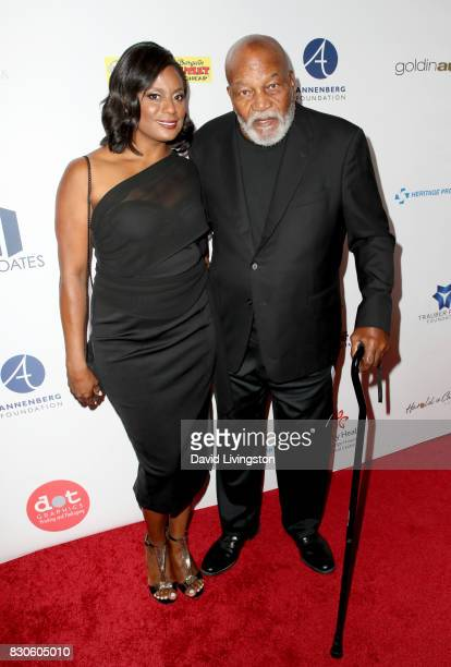 Monique Brown and Jim Brown and guest at the 17th Annual Harold Carole Pump Foundation Gala at The Beverly Hilton Hotel on August 11 2017 in Beverly...