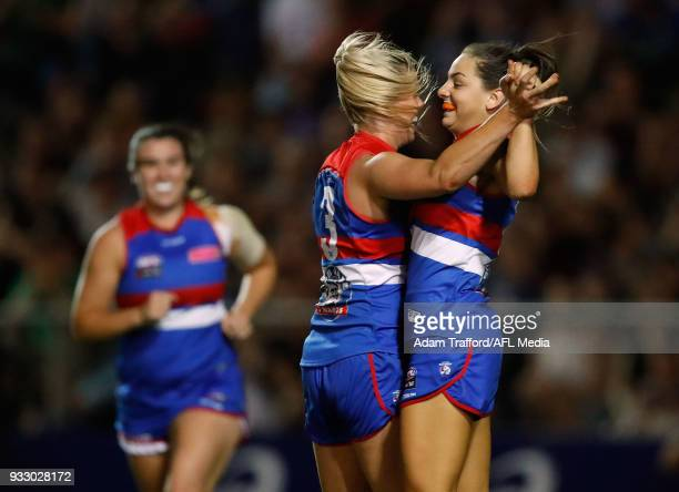 Monique Conti of the Bulldogs celebrates a goal with Katie Brennan of the Bulldogs during the 2018 AFLW Round 07 match between the Western Bulldogs...