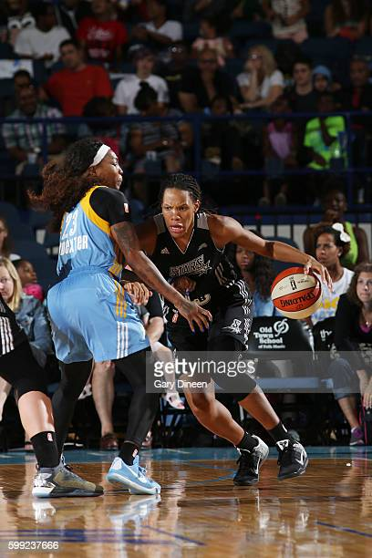 Monique Currie of the San Antonio Stars drives to the basket against Cappie Pondexter of the Chicago Sky on September 4 2016 at Allstate Arena in...