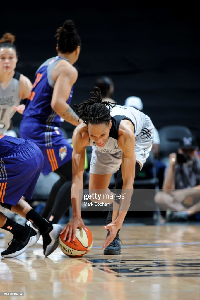 Monique Currie #1 of the San Antonio Stars runs for possession of the ball against the Phoenix Mercury on May 19, 2017 at AT&T Center in San Antonio, Texas.