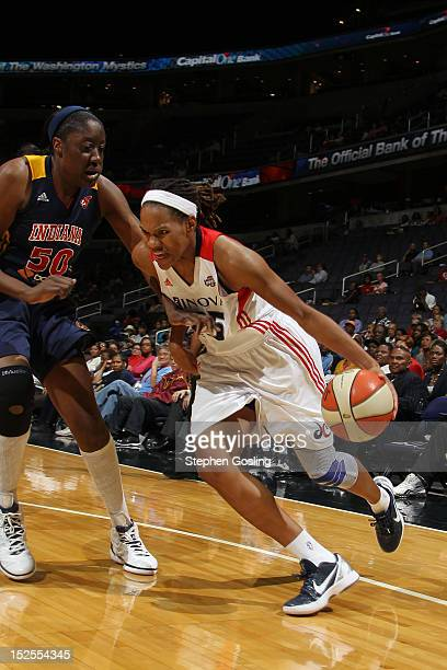 Monique Currie of the Washington Mystics drives against Jessica Davenport of the Indiana Fever at the Verizon Center on September 21 2012 in...