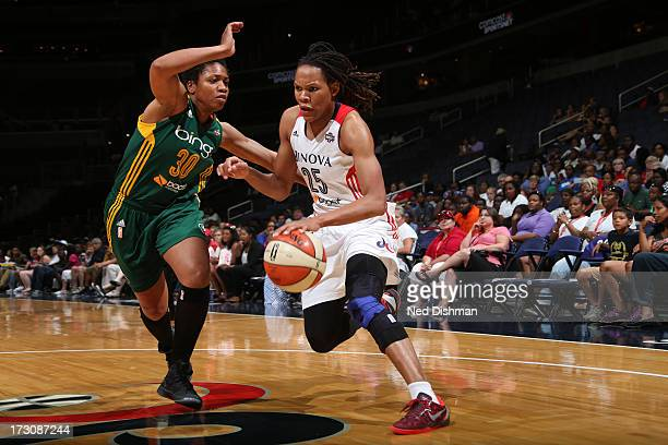 Monique Currie of the Washington Mystics drives against Tanisha Wright of the Seattle Storm at the Verizon Center on July 6, 2012 in Washington, DC....