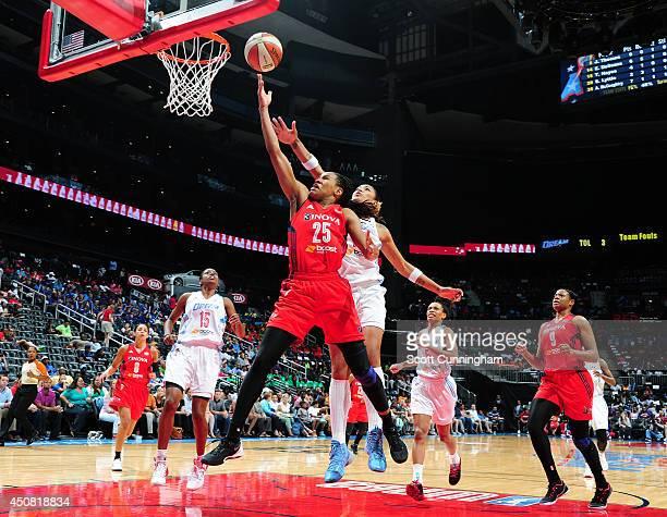 Monique Currie of the Washington Mystics puts up a shot against Erika deSouza of the Atlanta Dream on June 18 2014 at Philips Arena in Atlanta...