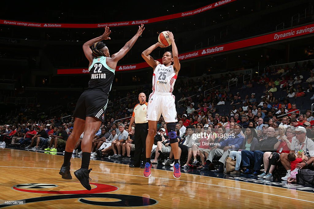 Monique Currie #25 of the Washington Mystics shoots against Charde Houston #22 of the New York Liberty at the Verizon Center on August 16, 2014 in Washington, DC.