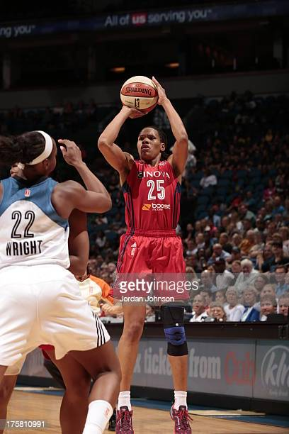Monique Currie of the Washington Mystics shoots against Monica Wright of the Minnesota Lynx during the WNBA game on August 8, 2013 at Target Center...