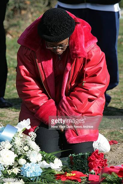 Monique Dixon kneels at the grave of her son Vasean Alleyne at Rockville Cemetery in Lynbrook LI Vasean and his friend Angel Reyes were mowed down by...