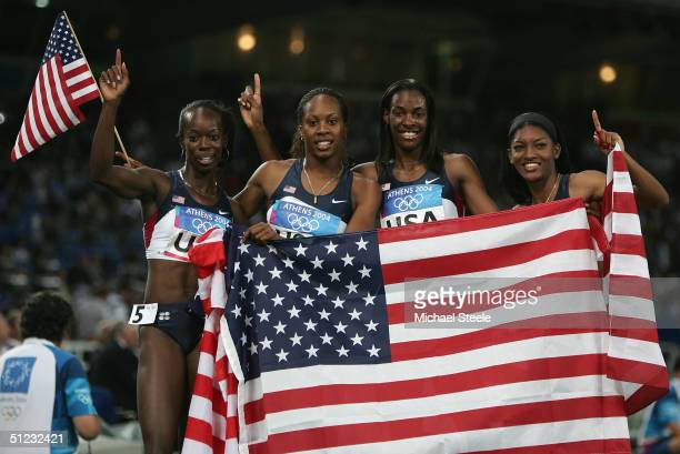 Monique Hennagan Sanya Richards DeeDee Trotter and Monique Henderson of the USA relay team celebrate as they won the women's 4 x 400 metre relay...