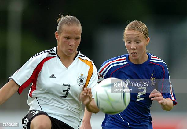 Monique Kerschowski of Germany vies for the ball with Elodie Cordier of France during the Women's U19 Europen Championship match between Germany and...