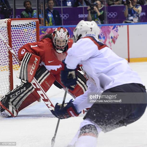 Monique Lamoureux tries to score against Canada's goalkeeper Shannon Szabados during the Women's Ice Hockey Gold Medal Game between Canada and USA at...