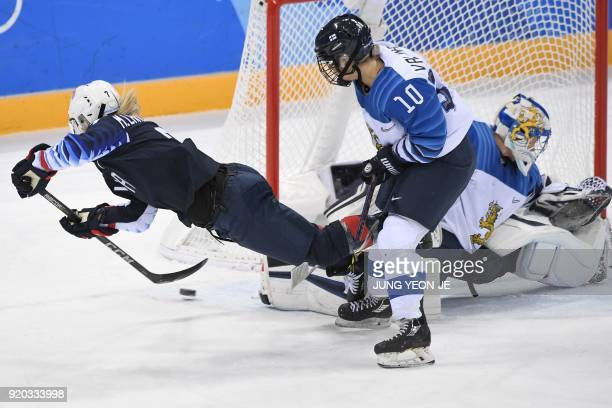 Monique LamoureuxMorando attacks Finland's goaltender Noora Raty in the women's ice hockey semifinal game between the United States and Finland...