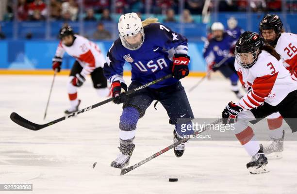 Monique LamoureuxMorando of the United States and Jocelyne Larocque of Canada battle for the puck in the first period during the Women's Gold Medal...