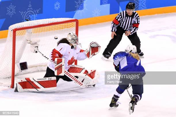 Monique LamoureuxMorando of the United States scores a goal against Shannon Szabados of Canada in the third period during the Women's Gold Medal Game...